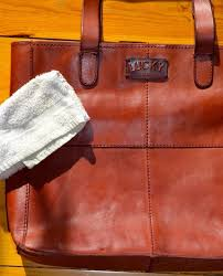 sometimes mother nature catches us and our leather off guard and the result is a splotchy water stained article this leather bag had dried water stains