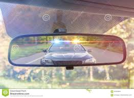 Cop Lights Rear View Mirror View On Rear Mirror Of A Car Police Car With Lights And