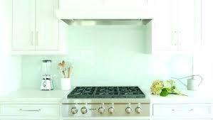herringbone backsplash glass herringbone white glass white kitchen cabinets with blue glass tile white glass subway