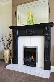 white big tile around fireplace modern chromed iron frame with black painted stove and glass fireplace design idea black wood crafted fireplace mantel with