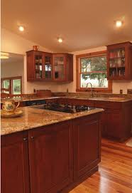 cabinets uk cabis: log cabin style with modern comforts yes please cabinets and island are cherry wood and the countertops are medium tone granite rustic kitchen
