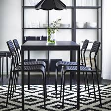 black furniture ikea. a black dining table with chairs and blackbrown storage combination furniture ikea m