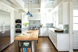 white cabinets with butcher block countertops added storage white cabinets with dark butcher block countertops
