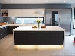 Modern Kitchen with Luxury Appliances, Black & White Cabinets, Island  Lighting, and a Backsplash Window Kitchen-Design-Ideas.