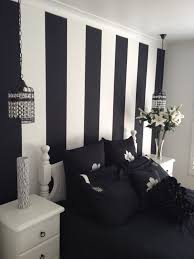 inspiring Painted Wall Designs For Bed room by black white stripped wall  feat black bedsheet between