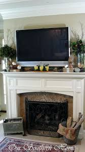 tv height over fireplace best above decor ideas on wall decor above shelf above and living tv height over fireplace