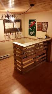 one could craft the pallet bar for his man cave in the work or garage to reduce waste the rough looking pallet above is a great fit for a man cave