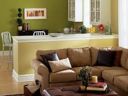 green walls brown leather sofas