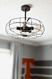 we removed the ceiling fan in favor of a caged light fixture reminiscent of a vintage school gym clock