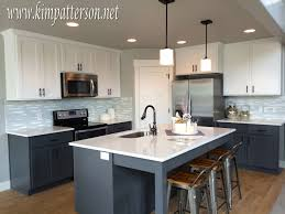 gray lower cabinets and white upper cabinets