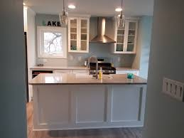 Maple Cabinets Painted White With Nimbus Quartz Countertops