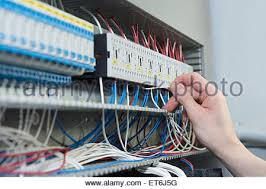 an electrician fixing a fuse box stock photo royalty image close up of electrician installing cable in distribution fusebox munich bavaria
