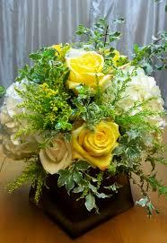 low centerpiece yellow rose white hydrangea square gold vase  www.breathtakingbridalbouquets.com