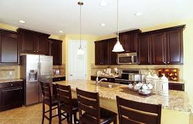 dark brown cabinets light granite kitchen with awesome