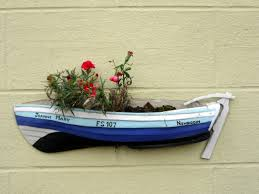 fishing coble planter front street newbiggin by the sea