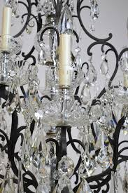 rococo revival large ten light chandelier with glass crystals and wrought iron open cage frame