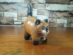 figurines wooden cat tail up