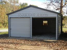 a tidy 20 x 20 metal garage with roll up doors
