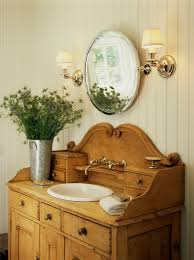an old dresser turns into a bathroom