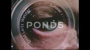 1950s Camera Lens Superimposed Over Human Eye Eye Chart