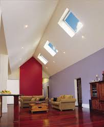 roof lighting design. an expansive living room with a tall cathedral ceiling in one side of the roof lighting design