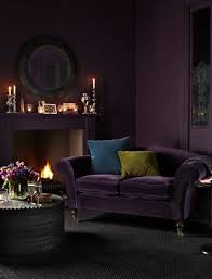 Aubergine sofa and walls
