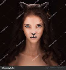 y catwoman female in with cat makeup and ears stock photo