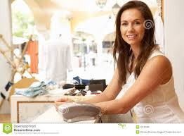 sales assistant in clothing store stock photo   image    sales assistant in clothing store