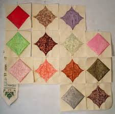 72 best Quilt Blocks - 5 & 10 Minutes images on Pinterest ... & Blocks with an extra swoop. Love the jewel tones palatte with the ivory  background. The cathedral windows are tacked with a pin in the center on  each side ... Adamdwight.com