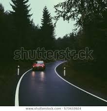 car driving down road. Brilliant Down Car Driving Down The Lonely Forest Road Inside Driving Down Road N