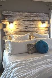 Whitewashed rustic headboard made from fenceposts - guest room?
