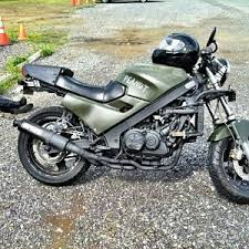 my 86 vfr700 streetfighter army green tank and fairing flat black frame and exhaust br knuckles to hold up the flat black yoshimura