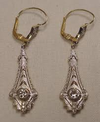 superb diamond platinum and 18k gold backed art deco style chandelier earrings the center diamond in each earring is an old mine cut measuring 35 points