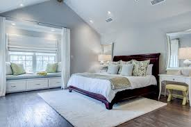 master bedroom with reading nook soft cream accent rug grey walls and side
