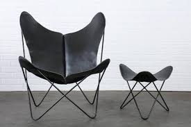 This is a Mid-Century Modern butterfly chair and ottoman with a vintage  wrought iron