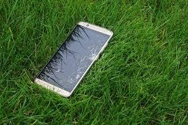 mobile phone on the grass ile ilgili görsel sonucu