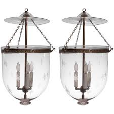 pair of large 19th century english bell jar lanterns with star etching for