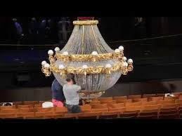 prepping the chandelier for the phantom of the opera
