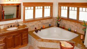 stone bath surround and tub deck in milwaukee bathroom