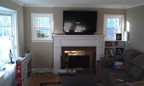 weathersfield ct tv mounted above fireplace with soundbar