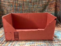 cut the flaps off the top of the box create an entrance for your cat to easily enter the box by cutting away at the side of the box leaving the t