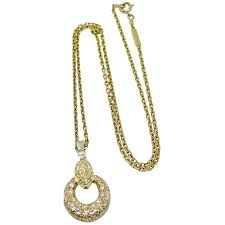 18k yellow gold diamond circle necklace to expand