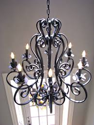 large wrought iron chandelier in foyer