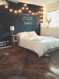 Chalkboard wall with string lights...love this idea for Drew's room in our
