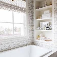 calcutta gold marble tiles behind bathtub