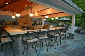 Outdoor kitchen with pizza oven traditional-deck