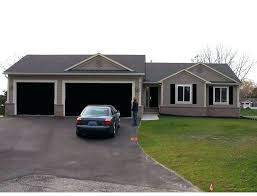 white house with black garage door black doors in house black doors on white houses white