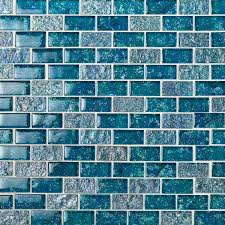 A variety of our glass tiles use recycled content, thus making it great for the environment. Laguna Iridescent Aquamarine 1x2 Brick Glass Tile Tilebar Com