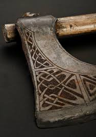 carved axe handle. carved axe handle