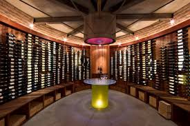wine room lighting. Interior Unique Home Wine Cellar Designs With Curved Bottle Closet Also Wooden Shelfs Plus Room Lighting